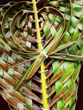 three layer: Coconut leaves are weaved together to be three layer of  heart shaped pattern . Stock Photo
