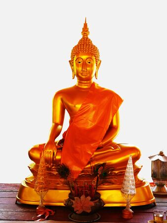 revere: A golden  Buddha statue  is carved out of metal and is the symbol of Lord Buddha. Stock Photo