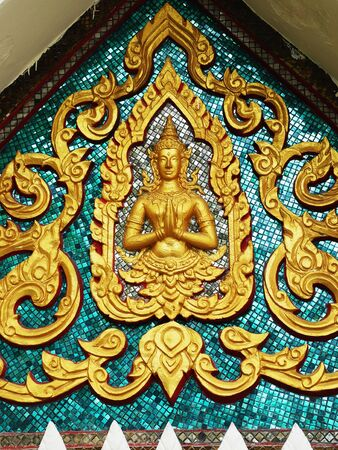 The Thai pattern of Angel blessing with heads of serpents are decorated on a triangular gable of a church. Stock Photo