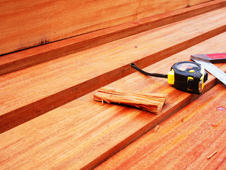 width: Measurement of wood length and width with Tsquare and ruler case.