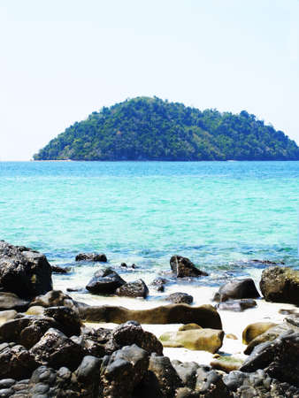 andaman sea: An island stands alone  in Andaman Sea of Thailand . This picture was taken from a rocky beach in March 2015 .