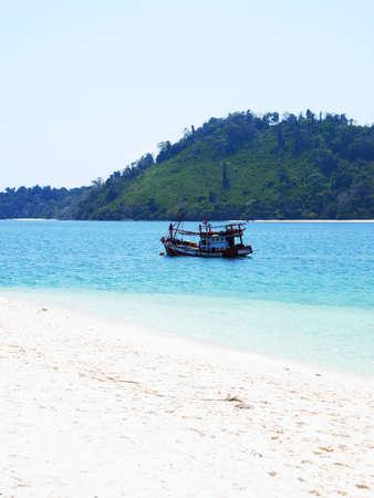 drove: A small fishing boat drove through a small channel of sea lane in Andaman Sea. Stock Photo
