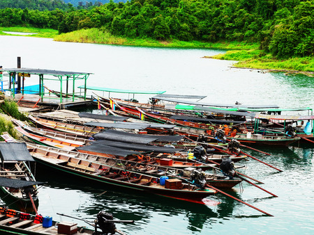 motor boats: Motor - boats moored alongside a pier. Stock Photo