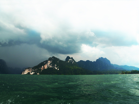 ranges: A big reservoir surrounded by ranges of mountains in Surat Thani , Thailand.
