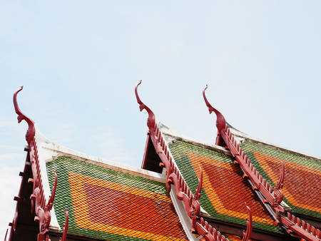 tiers: Thai church roofs decorated with colorful tiles in classic texture lie in three tiers.