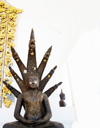 A style of Buddha image with seven - headed naga over his head as a guardian. Stock Photo