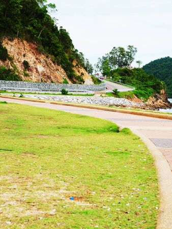 curvature: The uphill curvature of a road along coastal line in Chanthaburi Province , Thailand.