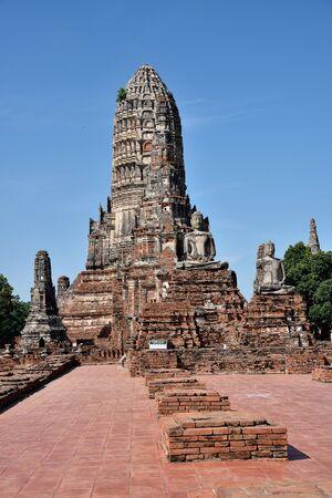 vicinity: Leading path to main pagoda and  ancient buddha statues and others around the vicinity. Stock Photo
