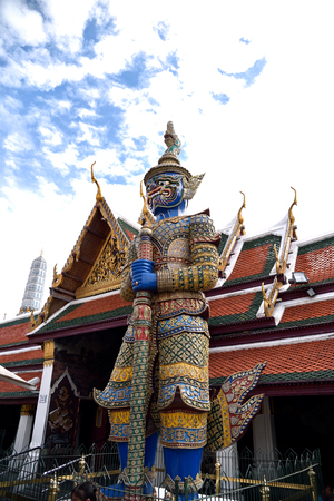 guarding: The deep blue giant stands guarding a temple gate in Wat Phra Kaeo, Thailand.
