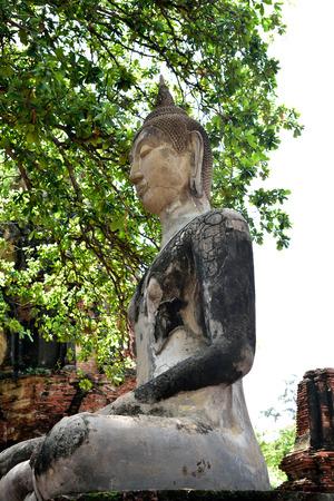 vihara: A buddha statue sat meditating in remains of a satellite vihara in Wat Mahathat , Ayutthaya Province , Thailand.