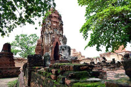 vihara: The large buddha statue sat meditating on a platform in a  ruined satellite vihara in Wat Mahathat , Ayutthaya Province , Thailand.