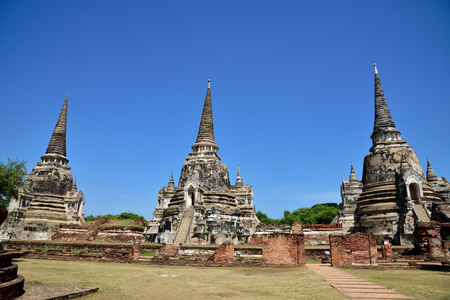 holiest: The three Chedis  built in the classic , Ceylonese design  located on a raise platform in Wat Phra Si Sanphet , Ayutthaya Province , Thailand.