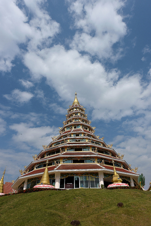 tiers: The 9 - storey Golden pagoda constructed on a mound in a temple in Chiangrai Province ,Thailand.