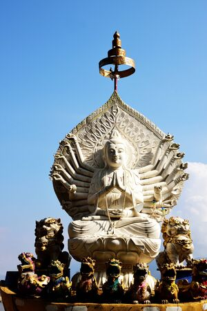 tiers: The Guanyin Thousand Hands , a Chinese goddess at Sob Ruak , Chiang Rai Province , Thailand. Stock Photo