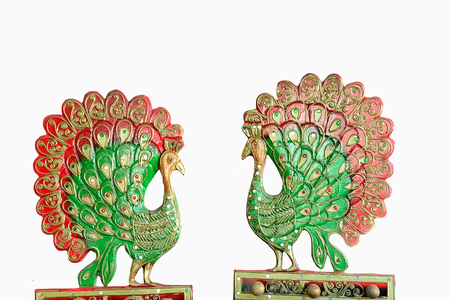 two faced: Sculptures of two peacocks  faced each other and spread their tails. Stock Photo