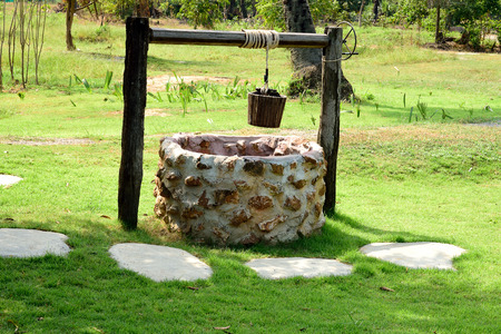 well water: The well water drawn by using wooden bucket that is raised mechanically  by hand.