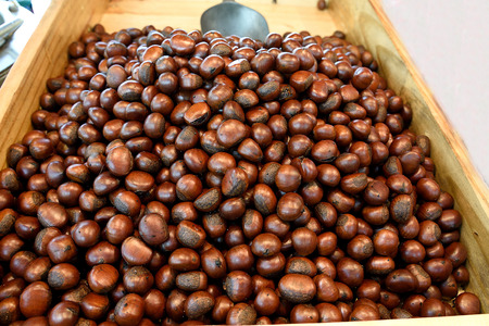 Roasted brown chestnuts sold in street by street vendors.