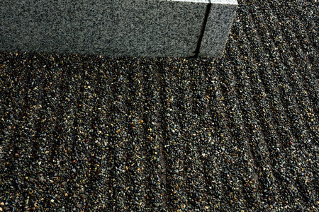raked: Raked gravel in linear patterns in a small Japanese garden.