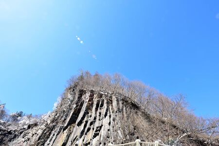 rifts: A cliff of a mountain with many cracks due to water and wind flows.