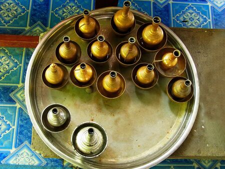 potation: The set of brass pots  used for pouring water of dedication to make a libation. Stock Photo