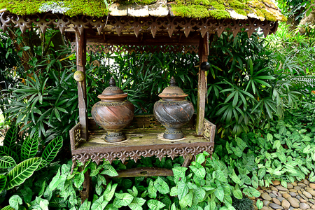 Ancient clay pots designed in Thai patterns are used for containing drinking water to welcome visitors.