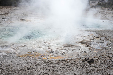 Spasmodic Geyser with erratic eruptions from a few inches to ten feet high locates in the Upper Geyser Basin , Yellowstone National Park in the United States.