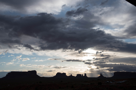The silhouette view of geologic features of sandstone in Monument Valley.