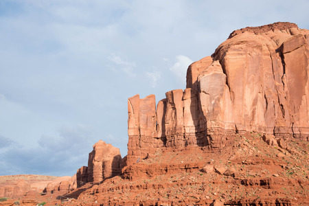 Red rocky buttes are clearly stratified with three princiiple layers.