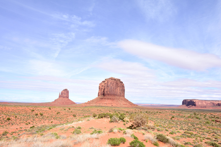 Sandstone pedestals , spires  and pinnacles  are highlighted in striking  view of blue sky
