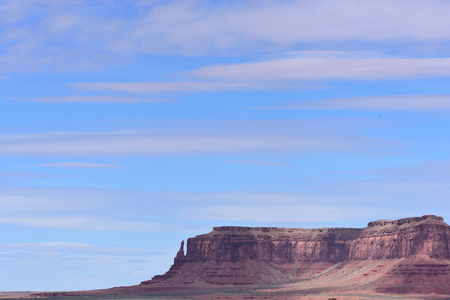 Sandstone pedestals and pinnacles  are highlighted in striking background view of blue sky.