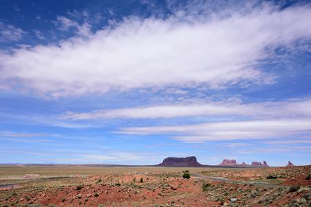 Natural sandstone formations  located in sandy area on  Utah-Arizona border. Stock Photo