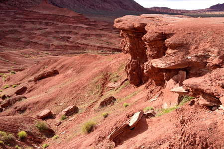 The vivid red color of rocks and sand of Monument Valley and stratified layers of rocks.