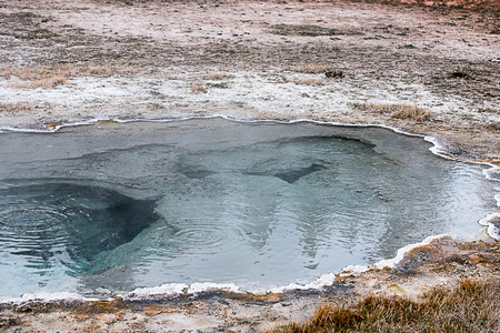 A thermal pool in mammoth area on the way to Morning Glory Pool  in Yellowstone National Park. Stock Photo - 87705237