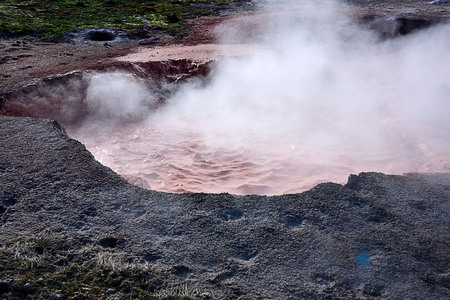 The Fountain Paint Pot with bubbling steam and gases from pink and gray clay mud.