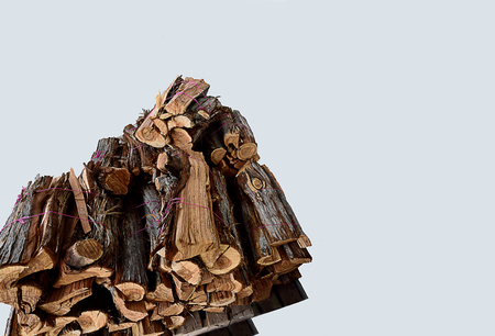 A stack of split firewood used as a fuel for cooking , heating , and for steam engines and steam turbines. Stock Photo - 87971259