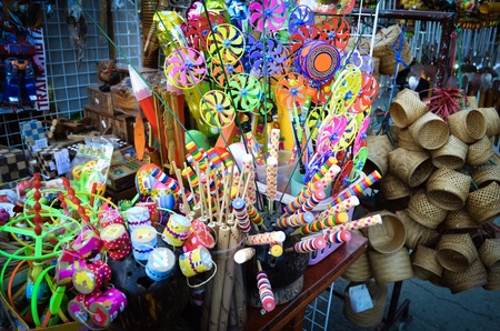 Colorful traditional toys ,wooden toys and woven boxes in the shop at street market in Thailand. Zdjęcie Seryjne