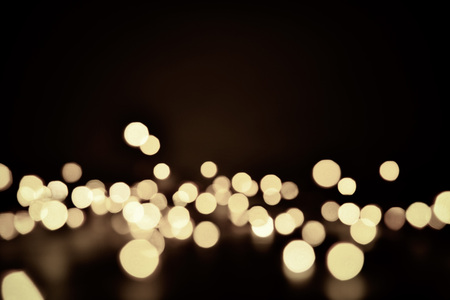 Abstract bokeh background of defocused lights. Merry Christmas and New Year background. Holiday glowing background and wallpaper. Blurred Bokeh. Zdjęcie Seryjne