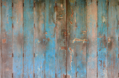 Old and dirty blue wooden door. Wooden door background texture. Wall and door decoration and design.