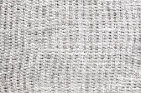 Beige canvas fabric texture. Woven sackcloth fabric pattern, background and texture.