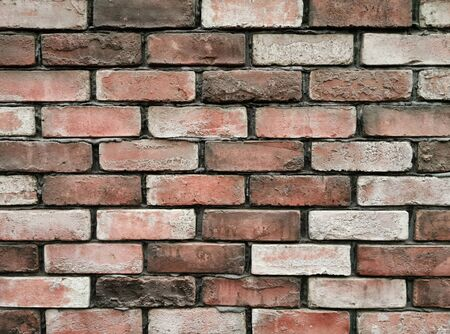 Brick wall background texture and wallpaper. Exterior wall decoration and design. Zdjęcie Seryjne