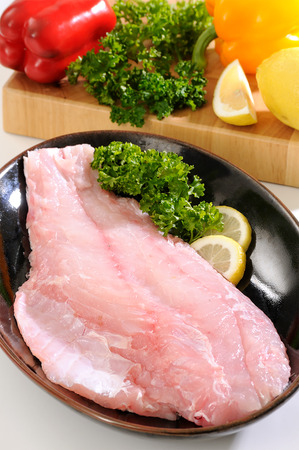 Grouper fish fillet.Several pieces of sea bass on a cutting board Stock Photo