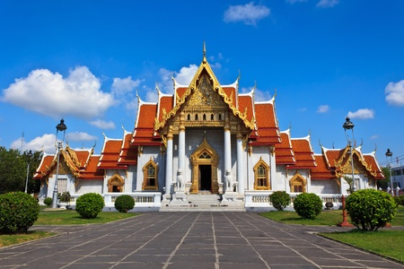 Marble Thai temple with blue sky photo