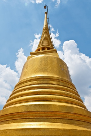 Golden Pagoda against blue sky photo