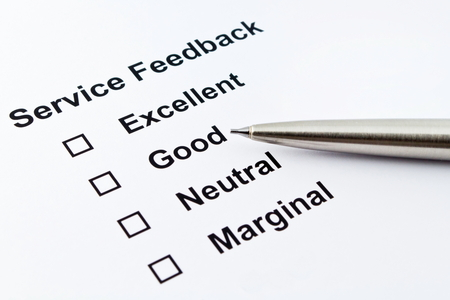 product reviews: service feedback evaluation with pen isolated over white background Stock Photo