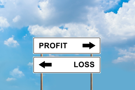 profit and loss road sign with blue sky photo