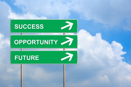 future success: Success, Opportunity and future on green road sign with blue sky Stock Photo