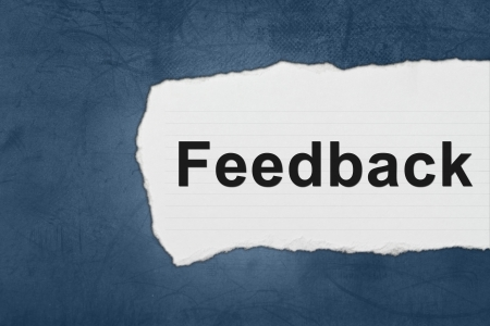 Feedback with white paper tears on blue texture photo