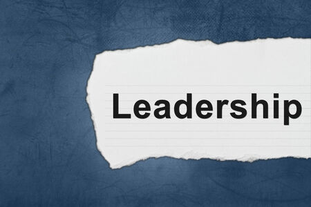 Leadership with white paper tears on blue texture photo