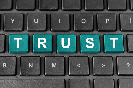 trust pastel turquoise word on keyboard Stock Photo - 26047262