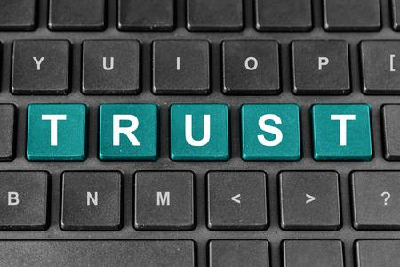 trust pastel turquoise word on keyboard Stock Photo - 26047262